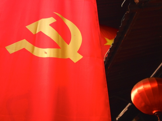 Red Communist flag and silk lantern, Hoi An, Viet Nam